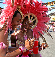 Two young women sharing photos during the morning parade in Trinidad, West Indies: 895_9598